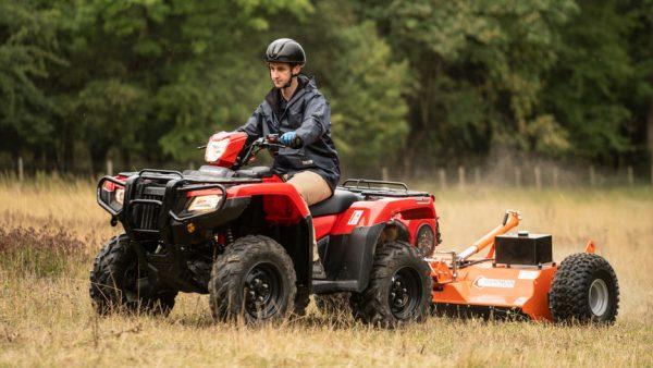 Honda trx520fa6 Quad with topper on field in farm